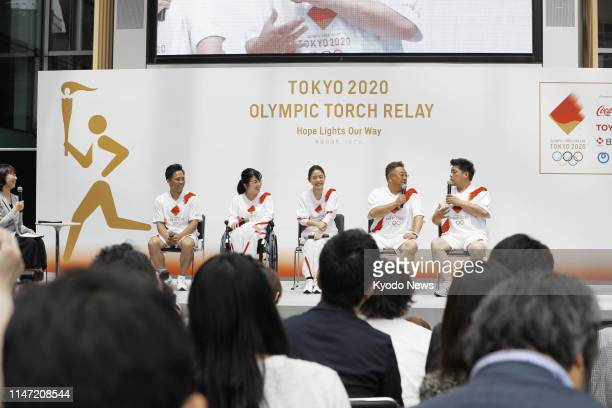 Photo taken in Tokyo on June 1 shows an event sponsored by the organizing committee of the 2020 Tokyo Games to announce the Olympic torch relay...