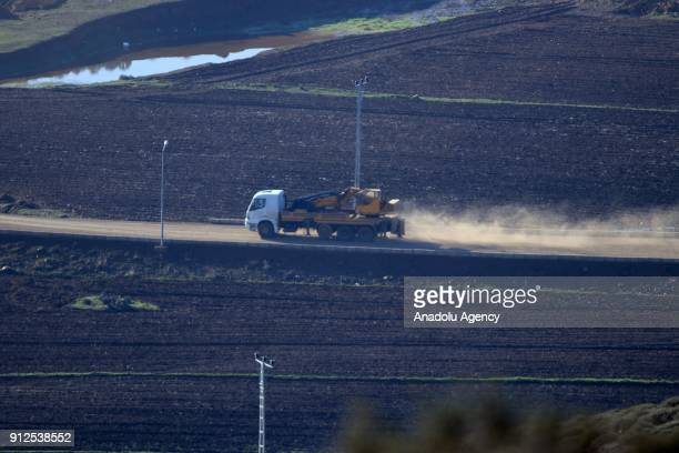 A photo taken in Turkey's Hatay province on January 31 2018 shows heavy construction equipment deployed to border as Turkish Armed Forces hit PYD/PKK...