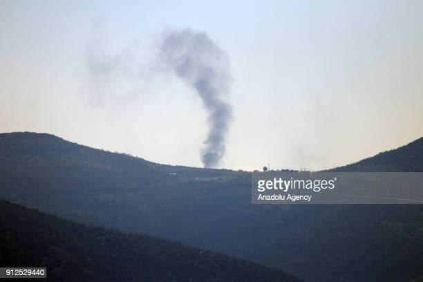 A photo taken in Turkey's Hatay province on January 31 2018 shows rising smoke as Turkish Armed Forces' howitzers continue to hit PYD/PKK terror...