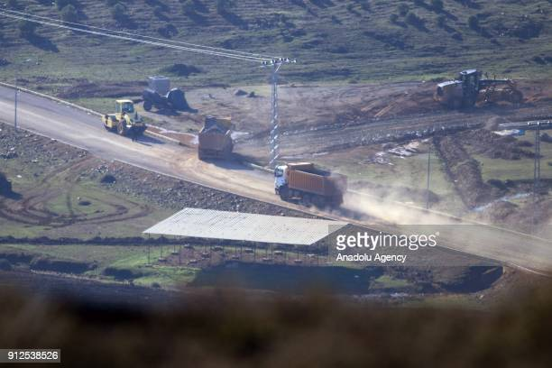 A photo taken in Turkey's Hatay province on January 31 2018 shows trucks and heavy construction equipment deployed to border as Turkish Armed Forces...