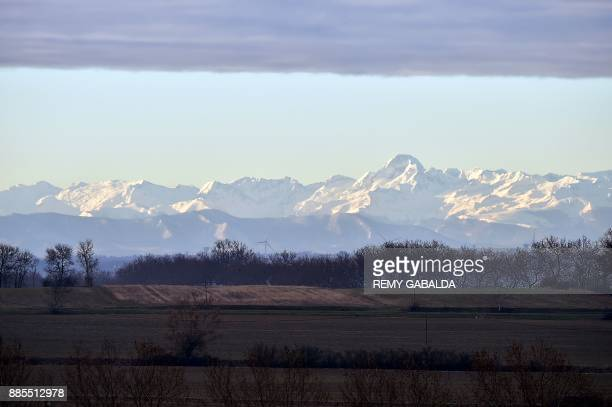 A photo taken in VillefranchedeLauragais on December 4 2017 shows snow covering the Pyrenees mountains / AFP PHOTO / REMY GABALDA