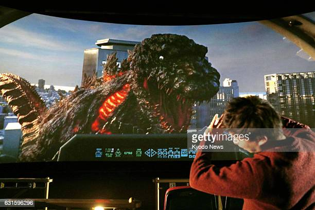 Photo taken Jan 12 shows a patron experiencing the new 4D Godzilla ride at Universal Studios Japan in Osaka The first Godzilla attraction at the park...