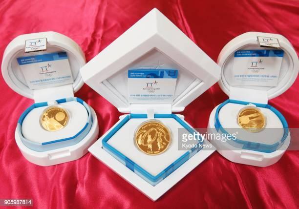 Photo taken Jan 17 shows Pyeongchang Olympic commemorative gold coins in Tokyo ==Kyodo
