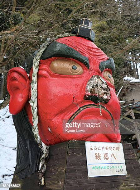 Photo taken Jan 19 in the city of Kyoto shows the face of a goblin minus its 23meterlong nose which broke off under the weight of snow The goblin is...