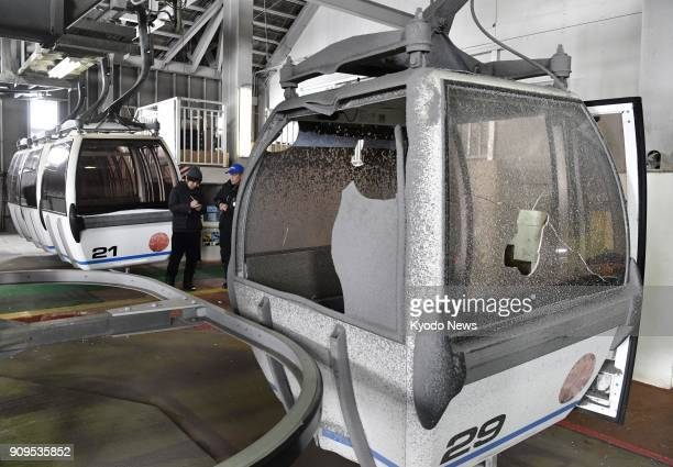 Photo taken Jan 24 shows gondola lifts with windows broken by volcanic rocks at the Kusatsu Kokusai Ski Resort near Mt MotoShirane in Gunma...