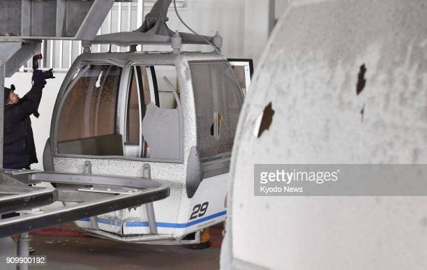 Photo taken Jan 24 shows the gondola lift at the Kusatsu Kokusai Ski Resort in Kusatsu eastern Japan with its capsules' windows broken by rocks and...