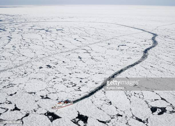 Photo taken Jan 30 from a Kyodo News airplane shows an icebreaker carrying tourists moving through drift ice off Hokkaido's Abashiri in Japan's north...