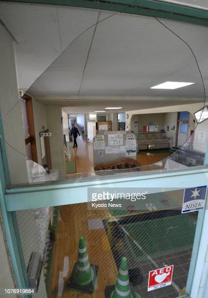 Photo taken Jan 4 shows a broken glass window at a junior high school in the town of Nagomi Kumamoto Prefecture after an earthquake with an estimated...