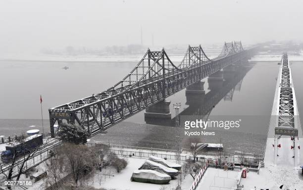 Photo taken Jan 8 from Dandong a Chinese border city with North Korea shows the SinoKorean Friendship Bridge Many North Korean workers have returned...