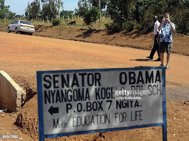 TOURISM Photo taken January 13 2009 shows a tourist at Nyang'oma in Kogelo taking photos of a road sign of a school named after America's President...