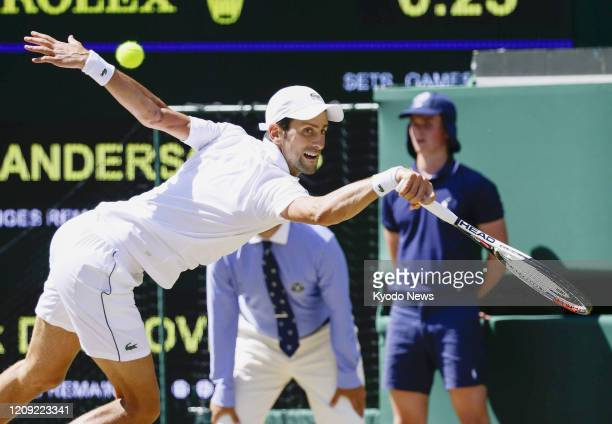 Photo taken July 15 shows Novak Djokovic of Serbia playing against Kevin Anderson of South Africa in the final of the Wimbledon tennis tournament in...