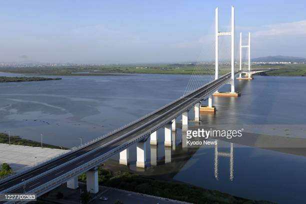Photo taken July 16 shows a China-North Korea border bridge yet to open over the Yalu River six years after its completion.