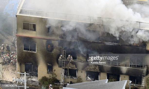Photo taken July 18 from a Kyodo News helicopter shows the threestory studio of Kyoto Animation Co in Kyoto after a man allegedly set it on fire The...