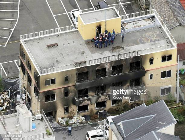 Photo taken July 20 from a Kyodo News helicopter shows an inspection continuing at the threestory studio of Kyoto Animation Co in Kyoto that was set...