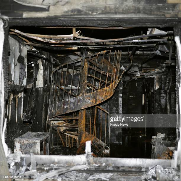 Photo taken July 20 shows the fireravaged spiral staircase of a Kyoto Animation Co studio in Kyoto which was set on fire by a man two days earlier...