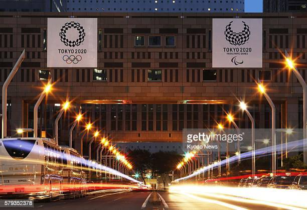 Photo taken July 23 shows the 2020 Tokyo Olympics emblems displayed on a building of the Tokyo metropolitan government It is just over four years...