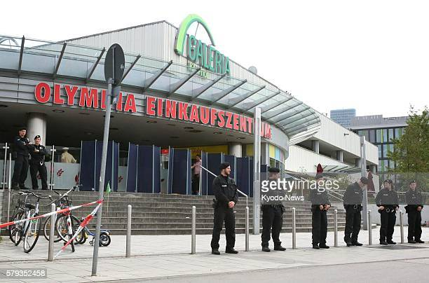 Photo taken July 23 shows the Olympia shopping center in Munich at which nine people were killed and more than 20 others wounded in a shooting...