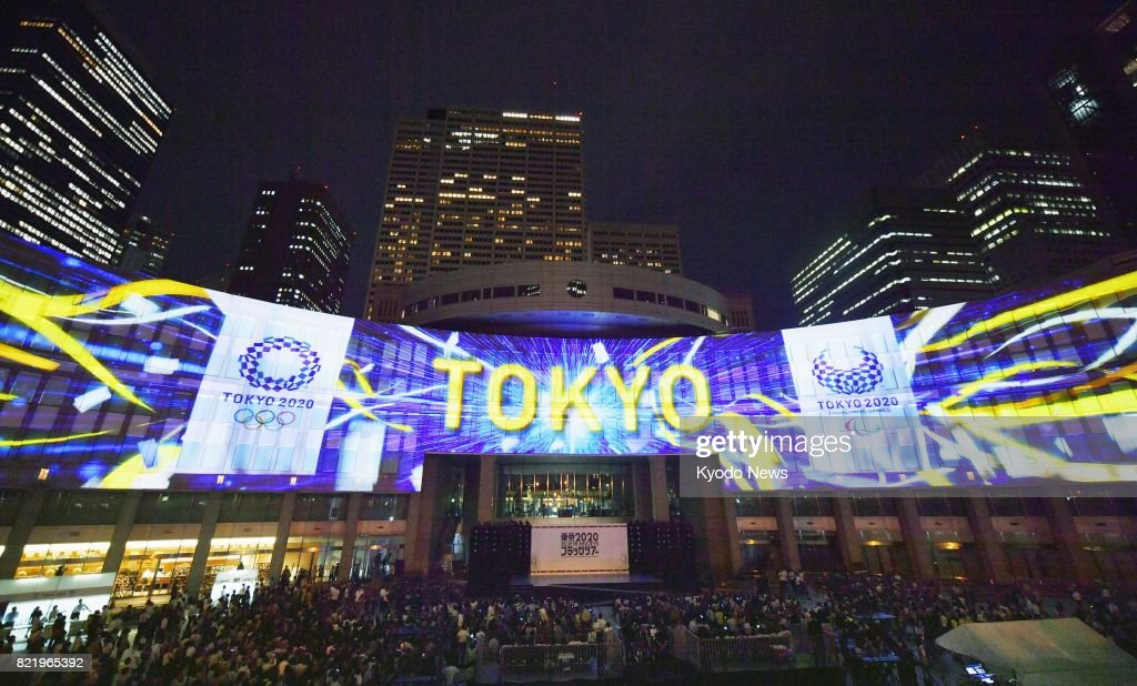 Photo taken July 24, 2017, shows projection mapping of the 2020 Tokyo Olympic and Paralympic emblems shown during an event held in front of the Tokyo metropolitan government building to mark three years to the start of the Summer Olympics in the Japanese capital. ==Kyodo