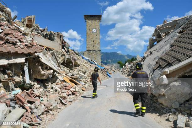 Photo taken July 29 shows a bell tower standing among rubble in the old city area of the earthquakedamaged central Italian city of Amatrice Prior to...