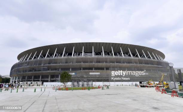 Photo taken July 3 shows Japan's new National Stadium in Tokyo, the main venue for the 2020 Olympics and Paralympics, under construction. ==Kyodo