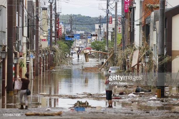 Photo taken July 4 shows an inundated street in Hitoyoshi, Kumamoto Prefecture, on July 4 after torrential rain in southwestern Japan.