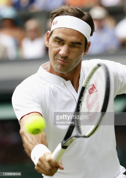 Photo taken July 4 shows Roger Federer of Switzerland playing against Lukas Lacko of Slovakia in the second round of the Wimbledon tennis tournament...