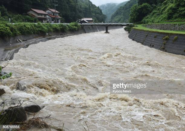 Photo taken July 5 shows a swollen river in the western Japan city of Hamada The Japan Meteorological Agency issued a special warning over heavy rain...