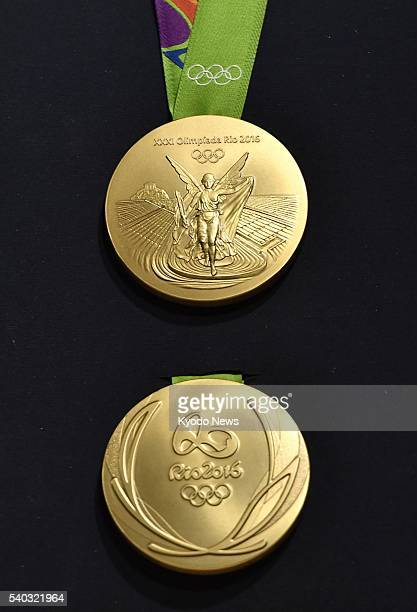 Photo taken June 14 in Rio De Janeiro shows two sides of a gold medal for the 2016 Rio Olympics unveiled by the organizing committee for the event...