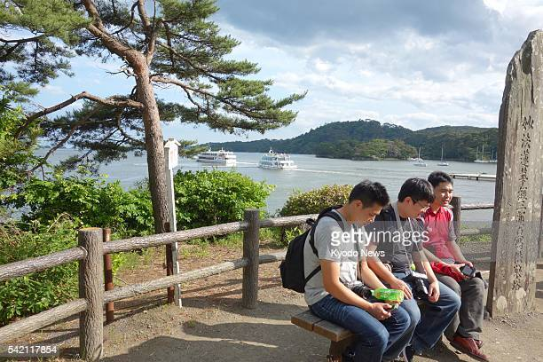 Photo taken June 17 shows a group of Taiwanese people taking an excursion in the northeastern town of Matsushima during a business trip to Japan The...