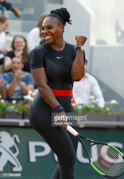 Photo taken June 2 shows Serena Williams of the United States celebrating after beating Julia Goerges of Germany in the third round of the French...