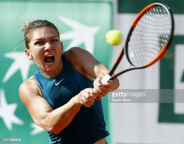 Photo taken June 2 shows Simona Halep of Romania playing against Andrea Petkovic of Germany in the third round of the French Open tennis tournament...