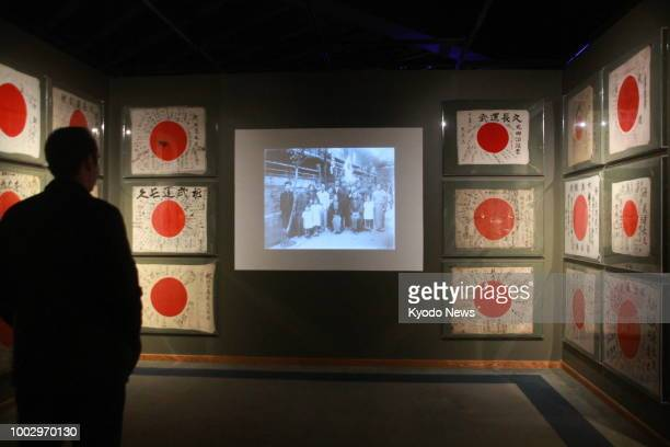 Photo taken June 25 shows a visitor to the Columbia River Maritime Museum in Astoria Oregon viewing Obon Society's exhibit of more than a dozen...