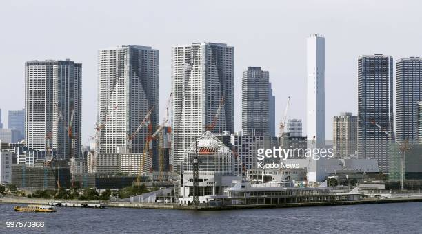 Photo taken June 28 shows highrise condominiums behind the athletes' village for the 2020 Tokyo Olympics and Paralympics under construction in...