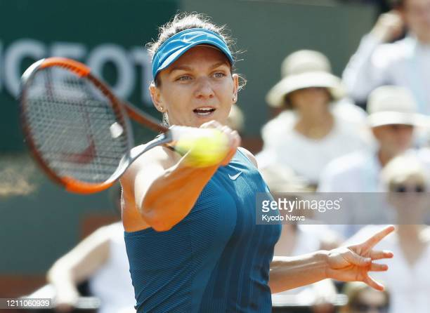 Photo taken June 7 shows Simona Halep of Romania playing against Garbine Muguruza of Spain in the semifinals of the French Open tennis tournament in...