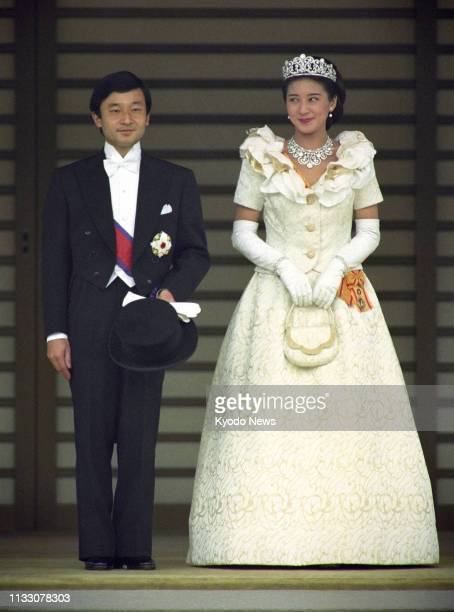 Photo taken June 9 shows Japanese Crown Prince Naruhito and Crown Princess Masako on their wedding day after an audience with the emperor and empress...
