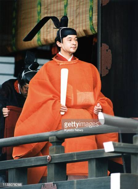 Photo taken June 9 shows Japanese Crown Prince Naruhito leaving Kashikodokoro part of the Imperial Palace Sanctuaries after a ceremony to exchange...