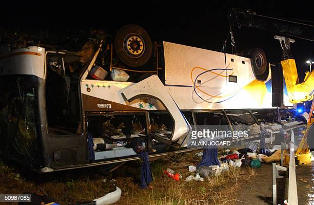Photo taken late 22 June 2004 shows the scene where at least 11 people were killed and six others seriously injured when a Moroccanregistered bus...