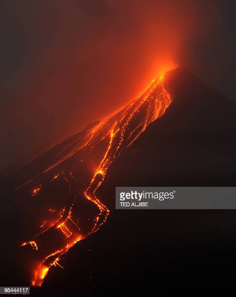Photo taken late December 25 2009 shows lava cascading on the slopes of Mayon volcano as seen in Santo Domingo town Albay province southeast of...
