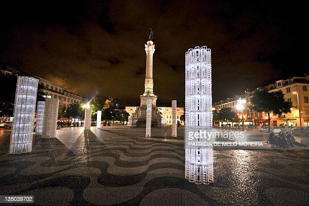 Photo taken late on December 5, 2011 shows artworks on Rossio Square in Lisbon. The crisis turned off the Christmas lights in Lisbon, but the...