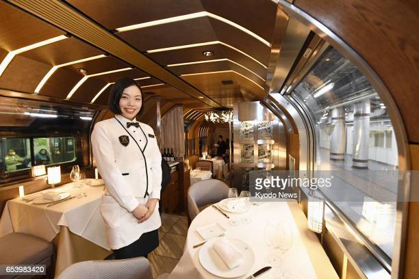 Photo taken March 16 at JR Ueno Station in Tokyo shows the dining room inside Train Suite ShikiShima East Japan Railway Co's new luxury sleeper train...