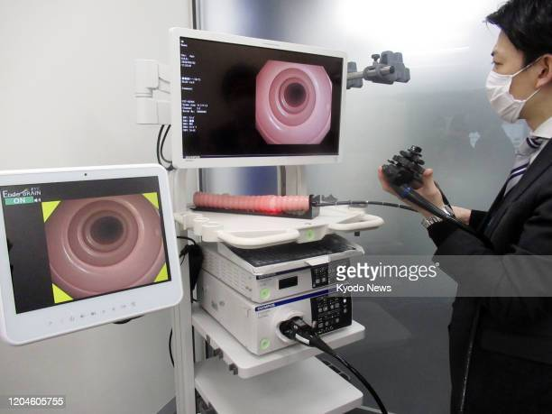Photo taken March 2 shows an AIbased gastrointestinal endoscopy system developed by Olympus Corp to detect cancer and other problems in the colon at...