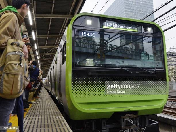 Photo taken March 7 shows a new East Japan Railway Co train on the Yamanote loop line in Tokyo resuming operations after they were suspended about...