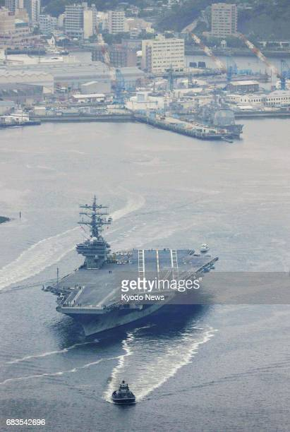 Photo taken May 16 from a Kyodo News helicopter shows the Ronald Reagan a US Navy aircraft carrier leaving its home port of Yokosuka southwest of...