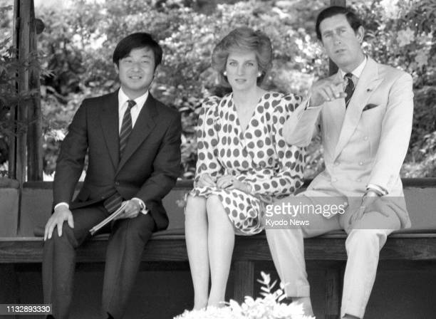 Photo taken May 9 shows Prince Hiro now Japanese Crown Prince Naruhito chatting with Britain's Prince Charles and his wife Princess Diana at the...