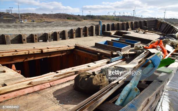 Photo taken Nov 27 shows an unidentified wooden boat found with eight dead bodies that washed ashore on the Sea of Japan coast in the city of Oga...