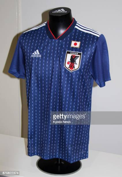 Photo taken Nov 6 shows the Japanese national soccer team's new jersey for the 2018 World Cup in Russia Players will first wear the jersey in a...