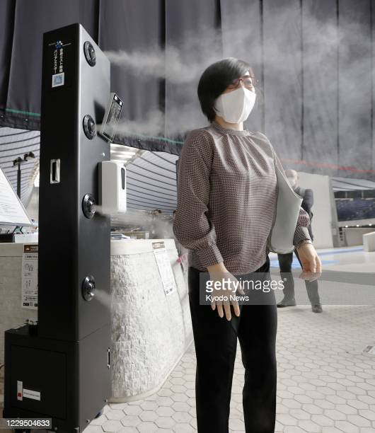 Photo taken Nov. 7 shows equipment installed at Yoyogi National Gymnasium in Tokyo to measure human body temperatures and disinfect people ahead of...