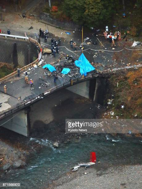 Photo taken Nov 8 from a Kyodo News helicopter shows the scene of a helicopter crash in which four Toho Air Service Co employees aboard were killed...