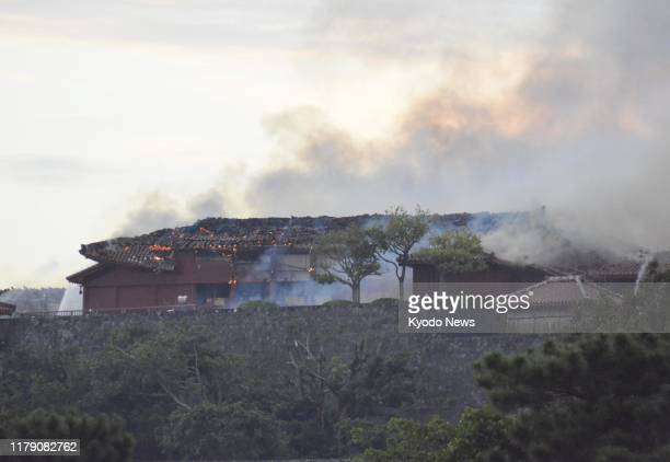 Photo taken Oct 31 shows smoke rising from Shuri Castle in Naha Okinawa Prefecture southern Japan after a fire broke out at the historic World...