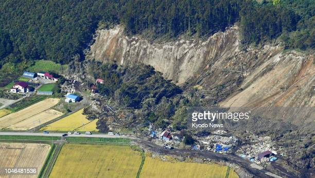 Photo taken Oct. 4 from a Kyodo News helicopter shows a massive landslide in Atsuma, Hokkaido, northern Japan, triggered by a powerful earthquake...